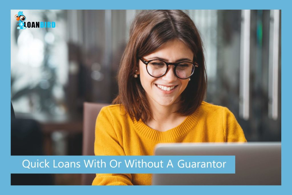 a happy woman applying online for a quick loan with no guarantor