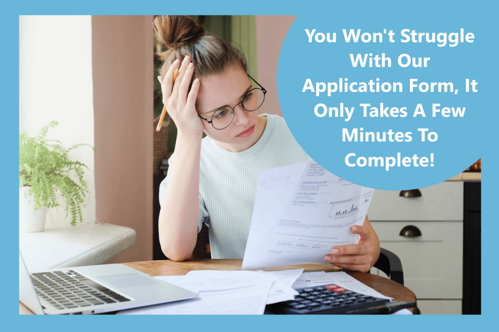 a woman looking through a loan application form